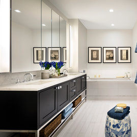 Custom walnut bathroom cabinetry with polished nickel hardware and imported Thassos polished marble countertop and floors, oversized marble showers and double vanities.
