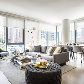 Large windows offer light-filled living with spectacular city views