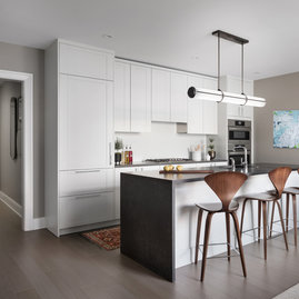 Kitchens feature Subzero built-in refrigerator, bottom mount freezer, Bosch Benchmark appliances including electric oven, gas cooktop, integrated dishwasher and microwave drawer.