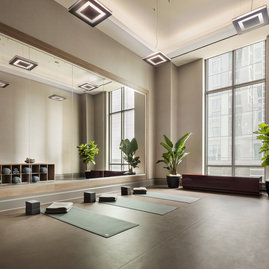 Fitness center is complimented with a yoga studio for mindfulness.