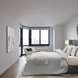 Open bedrooms feature stunning views and warm, inviting lighting.
