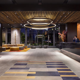 24/7 attended lobby with a modern, organic design by Clodagh.