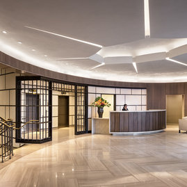 Grand lobby featuring marble and bronze finishes and a 24-hour concierge.