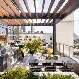Dine al fresco among the lush rooftop landscaping.
