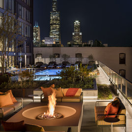Rooftop sun deck, complete with a pool and fire pit.