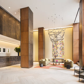 The grand double-height lobby is attended 24 hours a day by a concierge.
