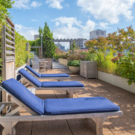 Landscaping on the roof deck offers a relaxing, natural environment.