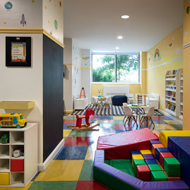 Children's playroom stocked with toys, books, and games.