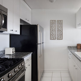The gourmet kitchens at Tribeca Park include GE appliances and granite countertops.