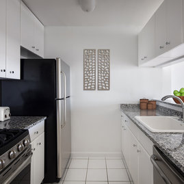 The gourmet kitchens at Tribeca Park include GE appliances and polished granite countertops.