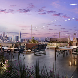 Rooftop Terrace with barbecue grills, fire pits and outdoor TVs set against views of the city skyline