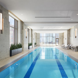 60 ft. indoor pool with access to an outdoor terrace overlooking Bennett Park.
