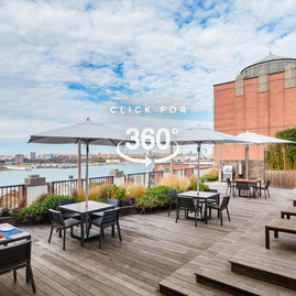 The landscaped rooftop sun terrace provides a perfect setting for enjoying gorgeous views of the city and the Hudson River.