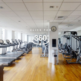 Our state-of-the-art private fitness center includes strength training equipment, cardio-theater with individual TV screens, and a gracious lounge.