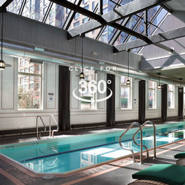 A skylit sixty foot heated swimming pool is adjacent to a state-of-the art health and fitness center.