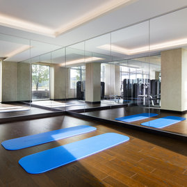 A private yoga studio, adjacent to the fitness center, is available to residents.