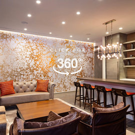 Socialize in a stunning lounge featuring lots of natural light, a large screen TV, open kitchen, sofas and tables for dining, conversation and games. The lounge is adjacent to the dining terrace.