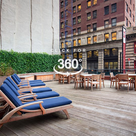 This lushly landscaped sun terrace complete with lounge chairs, tables and chairs provides the perfect setting to relax, refresh and recharge while enjoying views of the city.