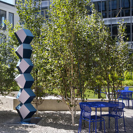 Set amongst the trees in Fifteen Fifty's private park are two of Angela Bulloch's colorful and geometric sculptures.
