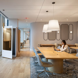 The resident-only co-working lounge includes individual workstations, private offices, and conferencing spaces.