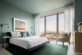 Spacious bedrooms include floor-to-ceiling windows.