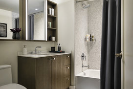 Custom bathrooms include imported Bianco Dolomite polished marble with marble mosaic feature walls