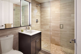 Custom bathrooms with oversized custom medicine cabinets.