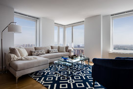 Light filled living rooms offering stunning views of New York City.