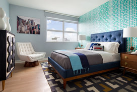 Top design firm Clodagh designed spacious model bedrooms with calming earth tones.
