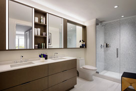 Imported Bianco Dolomite polished marble in bathrooms with marble mosaic feature walls.