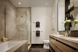 Master bathrooms feature Brazilian quartzite vanities and walls, St. Laurent marble floors and custom cabinetry.