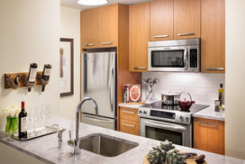 Walnut cabinetry, Italian marble countertops, and stainless steel appliances are just a few of the many ingredients that make these kitchens any chef's dream-come-true.