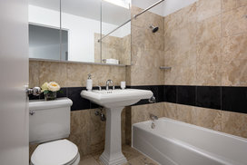 Bathrooms feature luxury finishes.