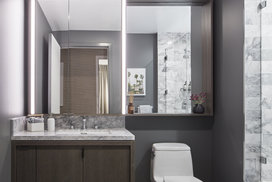 Luxe bathrooms include grey-oak vanities with marble counters and custom medicine cabinets.