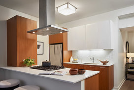 Gourmet kitchens with Snaidero duotone cabinetry and quartz countertops.