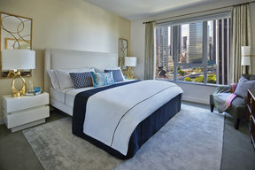 Expansive windows open to sweeping views of Downtown LA and beyond.