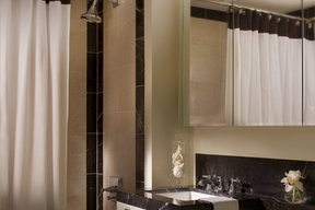 Custom bathrooms with Botticino beige marble