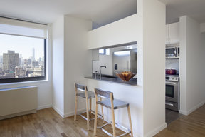 The gourmet kitchen at One Union Square South features Euro-style cabinetry and granite countertops.